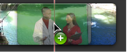 Image of dragging a green-screen clip over another video clip in the Project library.
