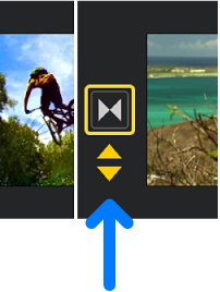 Yellow double arrows appearing below a transition in the timeline.