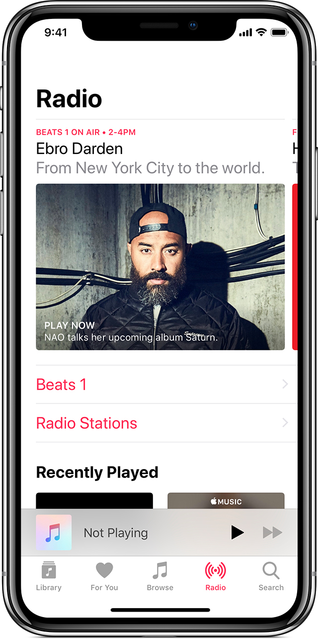 An iPhone X with Apple Music open to the Radio tab.