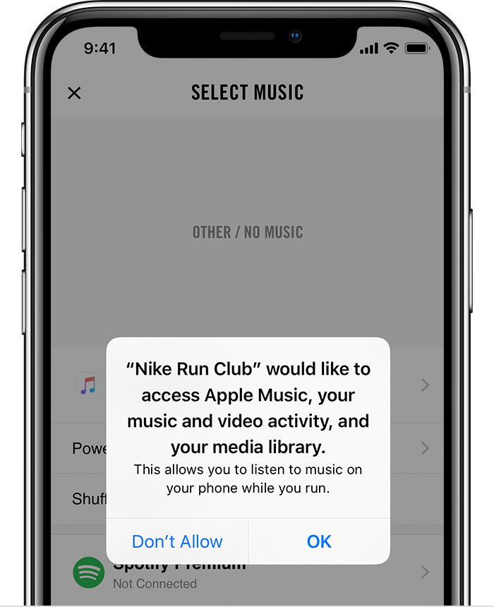 An iPhone X open to the Nike Run Club app. A message asking for approval for the app to access Apple Music is in the foreground.