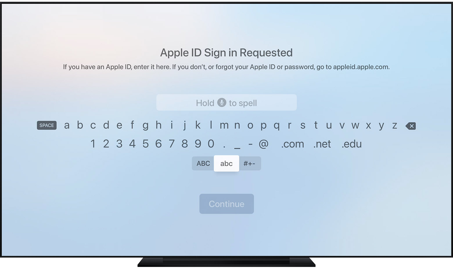 A screenshot on Apple TV shows a text field with an onscreen keyboard below it.