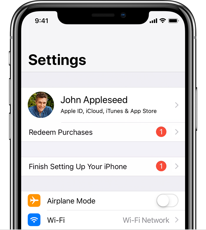 An iPhone X showing Settings. There are updates pending for Redeem Purchases and Finish Setting Up Your Phone.