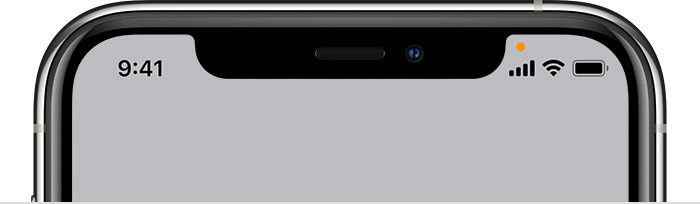 iPhone with orange indicator in status bar