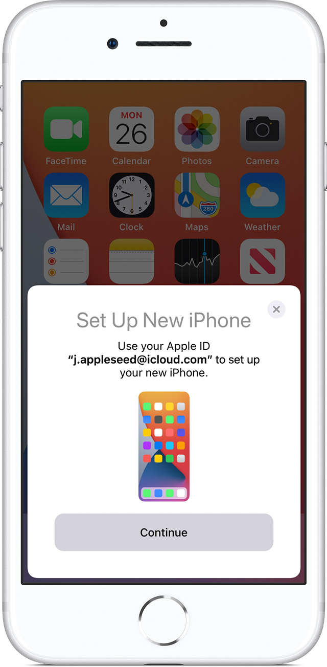 iPhone showing the Quick Start screen with a prompt to set up your new iPhone.