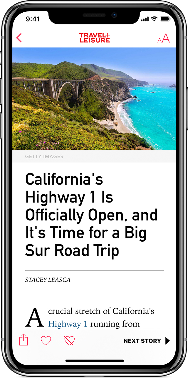 "An iPhone X showing the News app open to a Travel and Leisure article titled ""California's Highway 1 is Officially Open, and it's Time for a Big Sur Road Trip."""