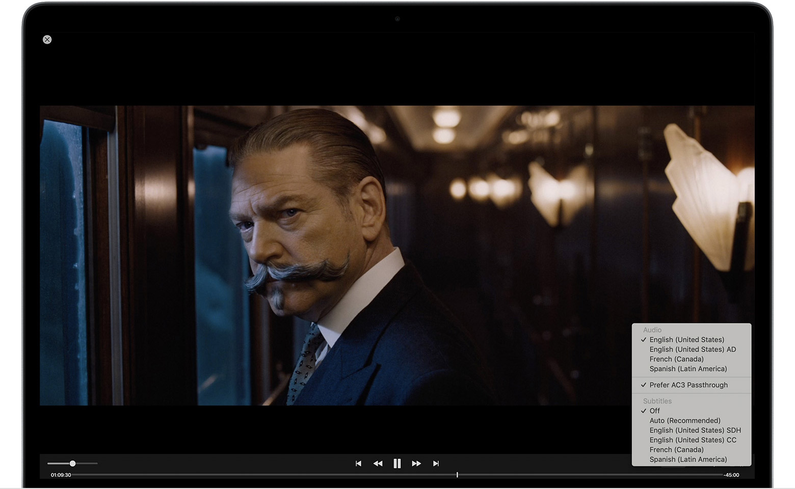 A cropped image of a Mac showing the movie Murder on the Orient Express paused. The Audio and Subtitles menu is open in the lower-right corner.