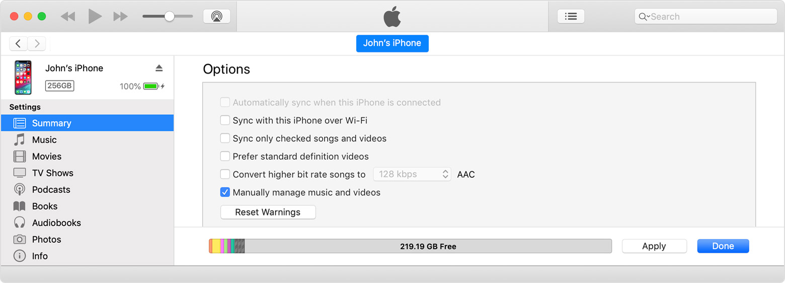 You can find the Manually manage music and videos checkbox in the list under Options.