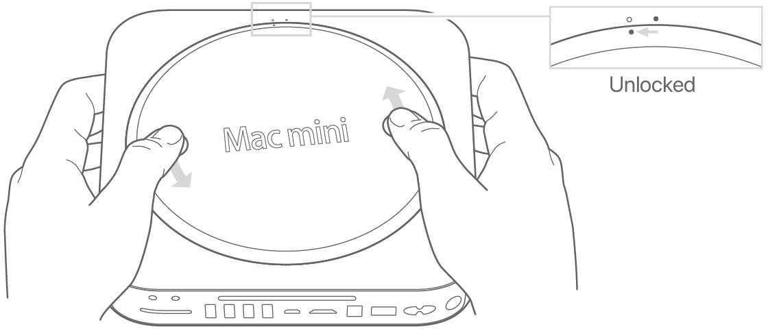 Two hands rotating the bottom cover of Mac mini