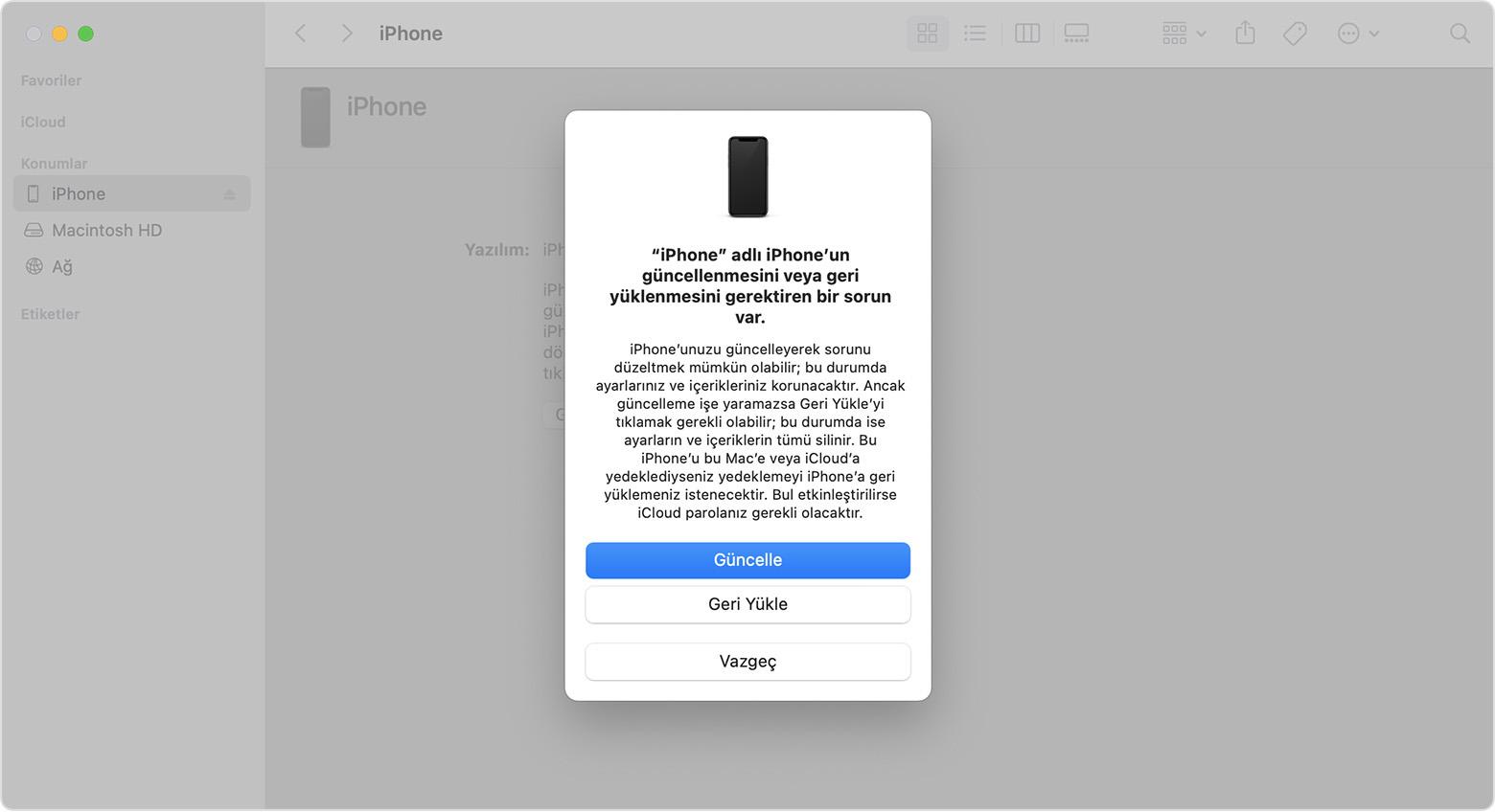 iPhone'unuzu güncelleme veya geri yükleme seçeneklerinin yer aldığı bir istem gösteren Finder penceresi. Güncelle seçilidir.
